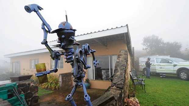 Police and Health Department officials removed Vossie Vorster's body from Malcolm Anderson's home. The sculpture outside the house is one of many on Anderson's Minerva Museum and Nature Reserve in Byrne Valley. Vorster shot Anderson on Wednesday before turning the gun on himself.