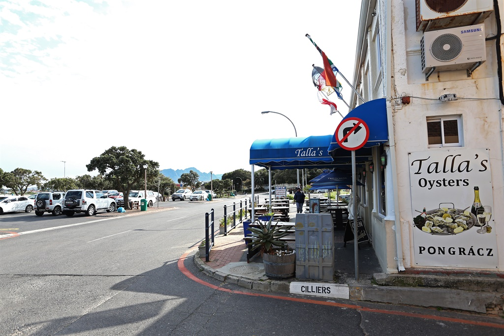 A general view of Tallas Tavern where a man was killed in point-blank head shot while sitting at a beachside restaurant in Gordons Bay.