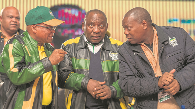 President Jacob Zuma, Deputy President Cyril Ramaphosa and ANC treasurer-general Zweli Mkhize chat ahead of Zuma's speech at the close of the ANC's policy conference in Johannesburg on Wednesday.