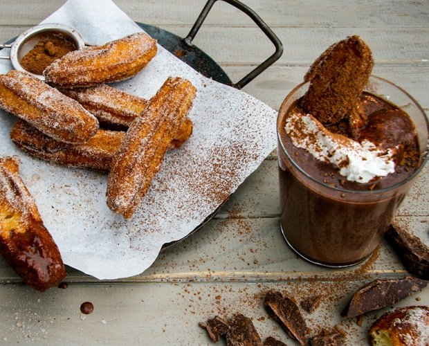 warm cup of hot chocolate with churros