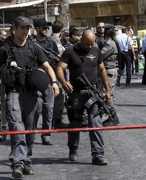 Israeli police secure the scene of the Jerusalem attack. (Mahmoud Illean, AP)