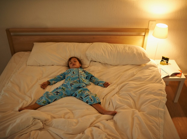 Child sleeping on bed