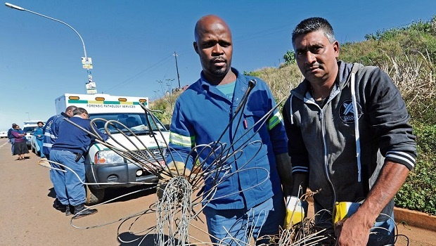 Mzungezwa Projects' Siyabonga Zuli (left) and Ivan Chetty hold up the electrical cables removed from the Copesville highway after a woman was electrocuted there.
