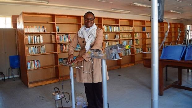 Mahlokazulu High School life science teacher Thoko Njoko, standing with the bio-sand filtration system she worked to help her pupils put together.