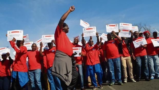 Police and Prisons Civil Rights Union (POPCRU) members took to Pietermaritzburg's streets yesterday to show solidarity with colleagues nationwide in demanding better treatment of police, traffic and prison employees.