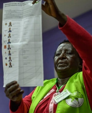An electoral Commission official counts ballots at a polling station in Nairobi. (AFP)