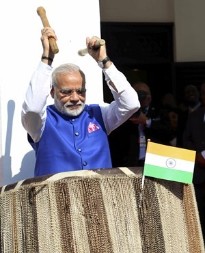 Indian Prime Minister Narendra Modi beats a drum at the entrance of State House in during Dar es Salaam. (Khalfan Said, AP)
