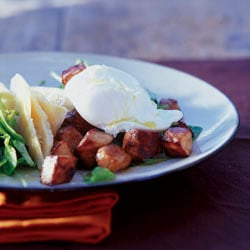 Crisp bacon and poached egg salad with warm orange