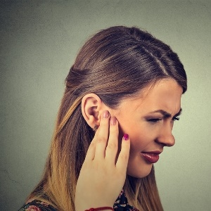 Woman with ringing in the ears
