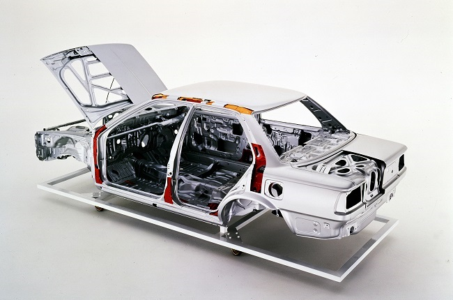 The bare chassis of a sixth generation Corolla