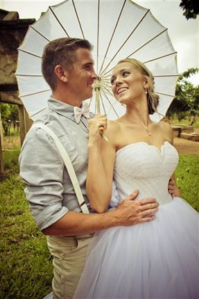 The bride, groom and the pretty parasol<br />