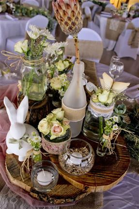 Beautiful variety of flowers in differently sized vases.<br />