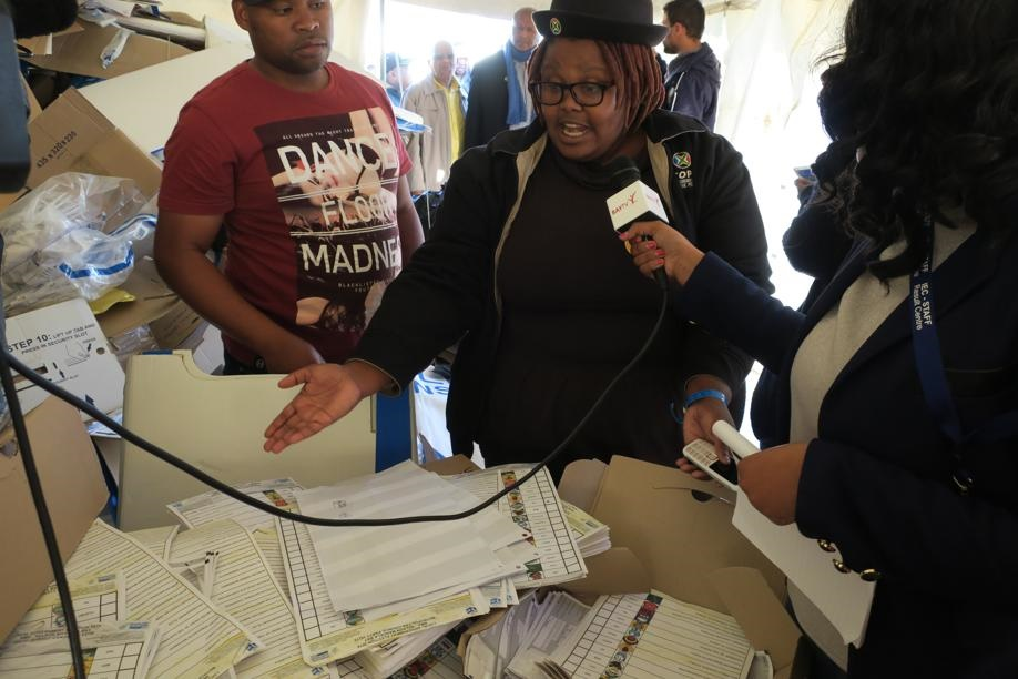 COPE, EFF and ANC members view ballot papers found in a tent at the Nelson Mandela Bay results centre. Picture: Lubabalo Ngcukana