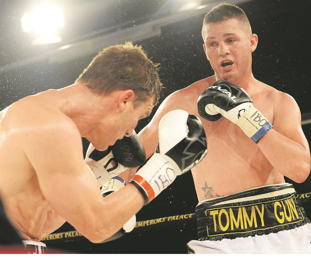 big hitter Tommy Oosthuizen (right) in action against Ryno Liebenberg at Emperors Palace last year. Boxing's enfant terrible will meet Daniel Bruwer on August 27 Photo: Duif du Toit / Gallo Image