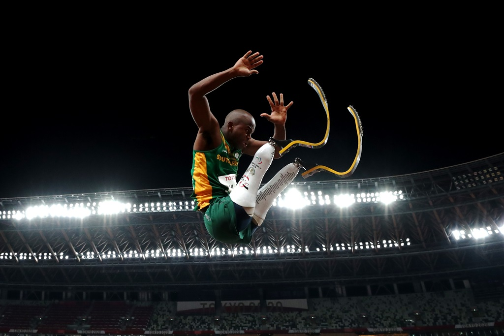 TOKYO, JAPAN - AUGUST 28: Ntando Mahlangu of Team South Africa competes in the Menâ??s Long Jump - T63 Final on day 4 of the Tokyo 2020 Paralympic Games at Olympic Stadium on August 28, 2021 in Tokyo, Japan. (Photo by Dean Mouhtaropoulos/Getty Images)