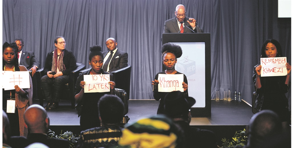 IN SOLIDARITY Simamkele Dlakavu (far right) and three other women hold a silent protest as President Zuma announces the municipal poll results  Picture: LEON SADIKI