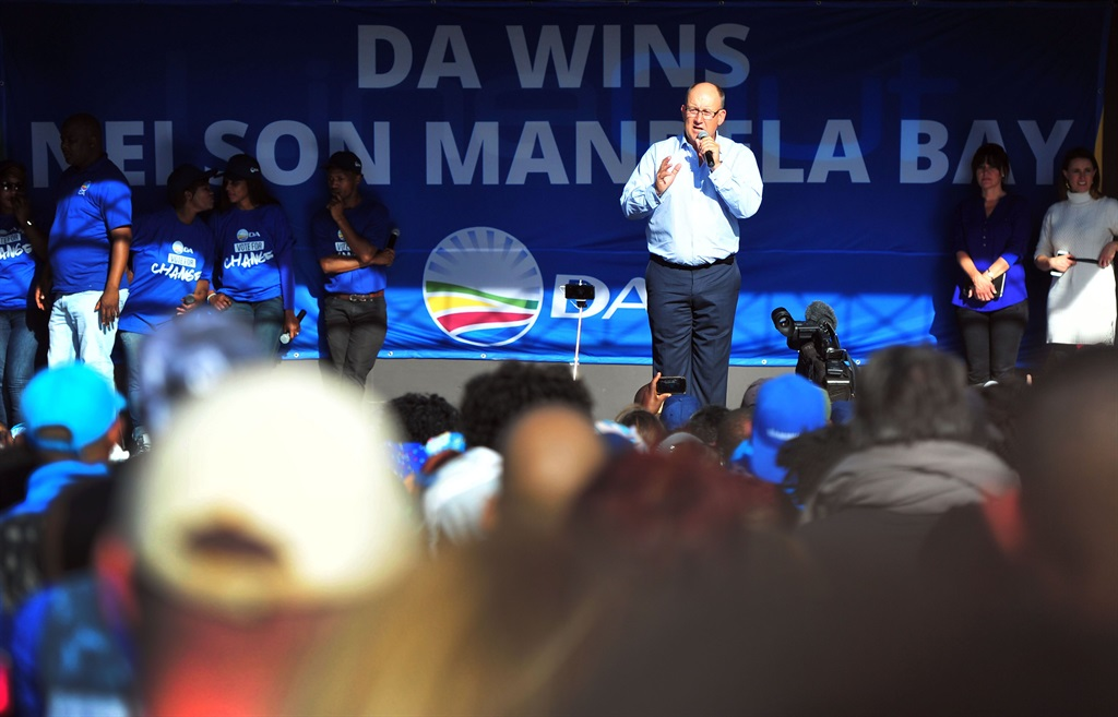 DA mayor Athol Trollip and Mmusi Maimane speak at the party's celebration of winning the Nelson Mandela Bay municipality in the 2016 Local Government Election in Port Elizabeth. Picture: Theo Jephta