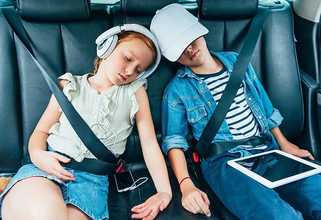 Children sleeping in car