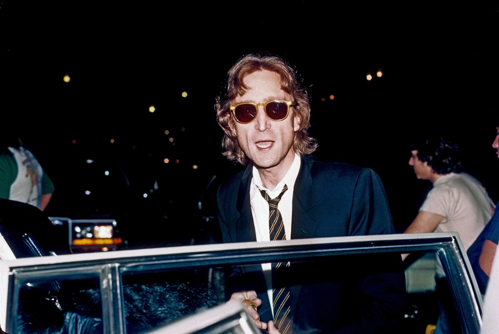 Former Beatle John Lennon arrives at the Times Square recording studio 'The Hit Factory' before a recording session of his final album 'Double Fanasy' in August 1980 in New York City, New York. (Photo by Vinnie Zuffante/Michael Ochs Archives/Getty Images)