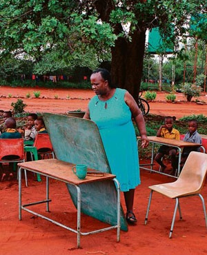 LEARNING UNDER A TREE A Grade 1 teacher in Limpopo is forced to conduct her lessons outside. A quality education is essential for tackling inequalities. Picture: Gallo Images / Sandile Ndlovu