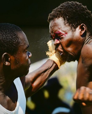 Fosta Madziba receives a blow from his opponent during traditional fist fighting at the VhaVenda Royal Heritage Festival. The king was in attendance. Picture: Leon Sadiki