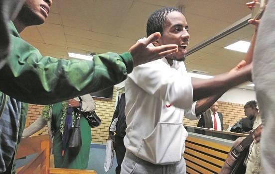 Supporters of the UKZN 11 clash with journalists inside the Pietermaritzburg Magistrate's Court on Thursday. Students seated in the public gallery attempted to stop journalists from taking photographs.