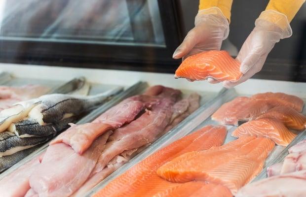 fishmonger selling salmon
