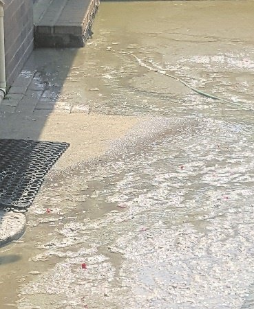 An Ernest Tooth Road resident has had ongoing problems with sewage overflowing and flooding her yard since last year.