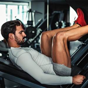 Man exercising his legs in the gym