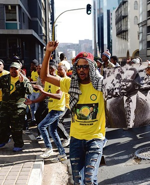 FAMILY FEUD Members of the Umkhonto weSizwe Military Veterans' Association march against members of the Occupy Luthuli House movement in a show of force to protect the ANC's headquarters. The Occupy members eventually delivered a memorandum of grievances to ANC secretary-general Gwede Mantashe. Picture: Felix Dlangamandla