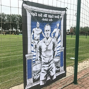 A tribute by Chinese Super League side Tianjin Teda fans to Olympic champion Eric Liddell.
