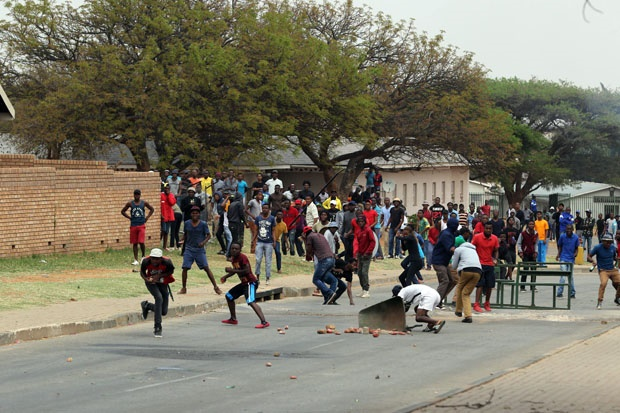 University of Limpopo students pelting stones at p
