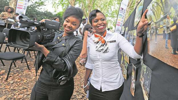 Dlamini (left), a third-year film technology student at Creative Arts College Pietermaritzburg, and Siphuxolo Ngqasa, marketing and communication officer at Sanbi KZN National Botanical Garden, celebrate the launch of Art in the Park 2017. The 55th Art in the Park takes place from May 3 to 7.
