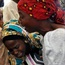 The families of the rescued 21 Chibok girls have been reunited with their daughters during a church service held in Abuja, Nigeria.