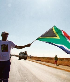 A protester holds up the SA flag during a service-delivery protest. TheANC's internal discussion documents admit that corrupt practices and arrogance by some in leadership positions are directly affecting social delivery. PHOTO: Bafana Mahlangu / Sow