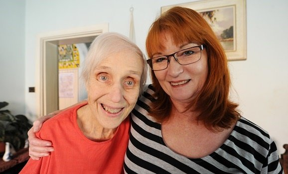 Barbie Burger (80) with her neighbour, Susan Keartland (L) photographed last year after her former pupils from Linpark High School raised money to pay for her exorbitant electricity bill.