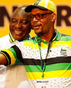 The newly elected ANC president, Cyril Ramaphosa takes a selfie with party member Pule Mabe at the ANC's elective conference in Johannesburg in December 2017. (Themba Hadebe, AP)