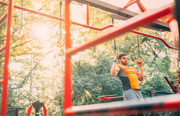 Man exercising in outdoor gym