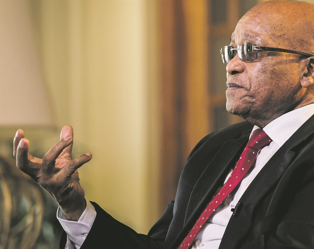 "Jacob Zuma, South Africa's president, gestures whilst speaking during a Bloomberg Television interview at his state residence in Pretoria, South Africa, on Tuesday, Oct. 27, 2015. South Africa's economy is in trouble because of the global slowdown and the government faces a ""serious struggle"" to meet its economic plan to cut unemployment and boost growth, Zuma said. Photographer: Waldo Swiegers/Bloomberg via Getty Images PHOTO:"