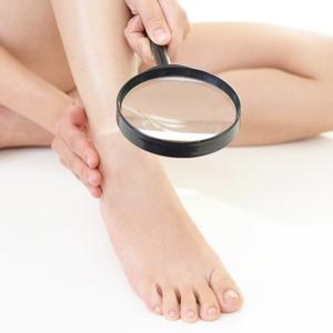 Woman examining her feet