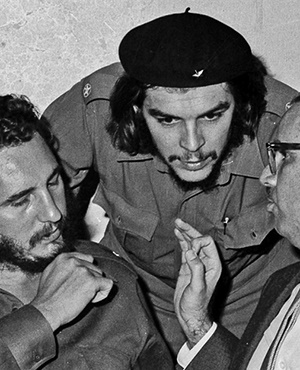 In this 1960 file photo, Cuba's revolutionary hero, Ernesto 'Che' Guevara, centre, flanked by Cuba's then prime minister, Fidel Castro, to the left and then president Osvaldo Dorticós, attend a reception in an unknown location in Cuba. Castro died, aged 90, on Friday night. Picture: AP Photo /Prensa Latina via AP Images / file