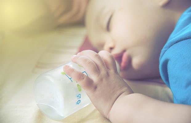 Baby asleep with bottle
