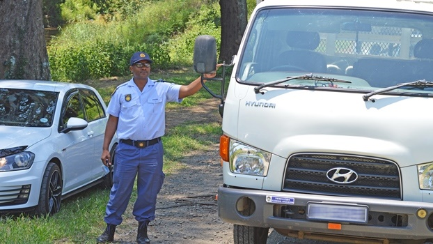 Pietermaritzburg police spokesperson Sergeant Mthokozisi Ngobese stands next to the hijacked truck  that was recovered by the Pietermaritzburg Rapid Response Unit on Tuesday morning.