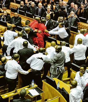 Members of the EFF are taken out of Parliament during the president's state of the nation address earlier this year. PHOTO: Lerato Maduna
