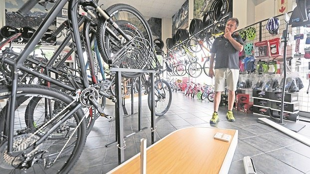 Jowetts Cycles manager Wally Flint stands near the display stand where three Merida Full Suspension bicycles were stolen from early on Tuesday morning.