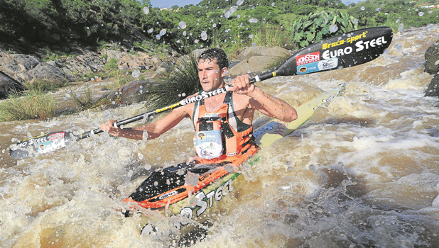 Men's day one winner Andy Birkett shoots Mission Rapids during the first leg of the Dusi Canoe Marathon on Thursday.