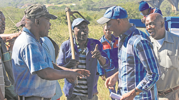 Residents of an informal settlement in Mkondeni confront a man acting on behalf of a private company that tried to demolish newly built shacks.