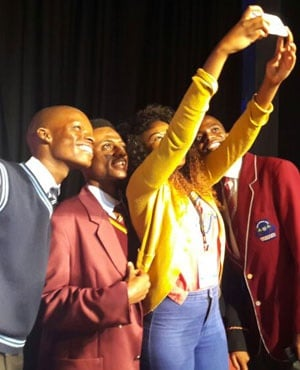 Matric top achiever pose for a selfie. (News24)