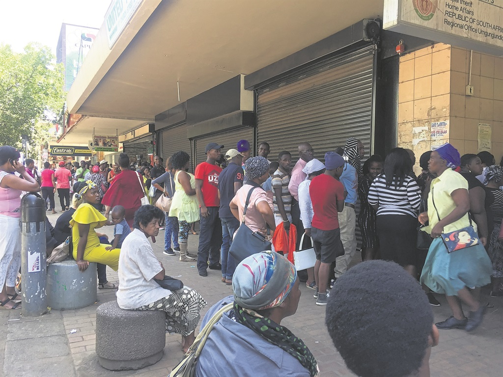 People queue outside the Home Affairs building on Church Street. Photo: Nokuthula Khanyile