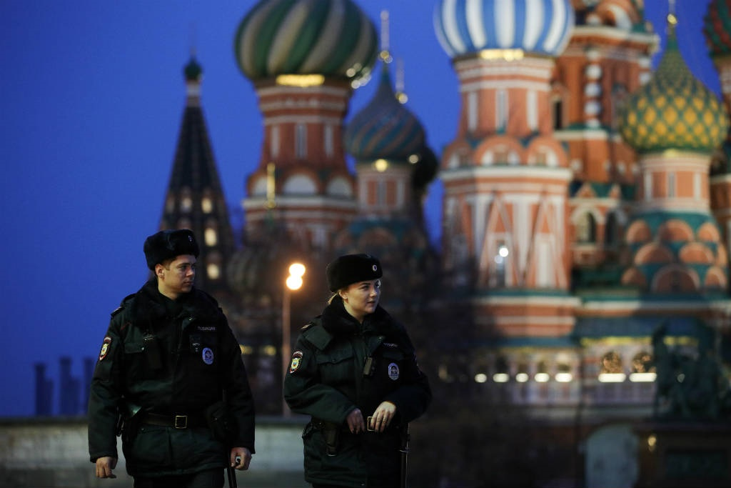 Police officers in Red Square in central Moscow amid the novel coronavirus (Covid-19) pandemic on 29 March 2020.